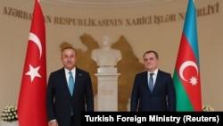 AZERBAIJAN -- Turkish Foreign Minister Mevlut Cavusoglu (left) meets with his Azeri counterpart Ceyhun Bayramov in Baku, November 1, 2020