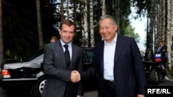 Russian President Dmitry Medvedev (left) is greeted by his Kyrgyz counterpart, Kurmanbek Bakiev, at the CSTO summit in Cholpon-Ata in late July.