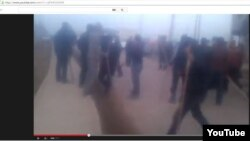 Скриншот видеоролика в YouTube о событиях (предположительно) в селах Сарыагашского района Южно-Казахстанской области. 6 февраля 2015 года.