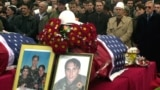People in Pristina pay their last respects in 2002 to the three Bytyqi brothers who were killed in Serbia in 1999.