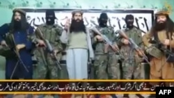 An image taken from a video released by a faction within the Pakistani Taliban on January 22, 2016 shows their leader Umar Mansoor (C) with militants delivering a statement from an undisclosed location.