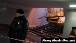 A Russian police officer attends the scene of a crash involving a passenger bus in a Moscow underpass on December 25.