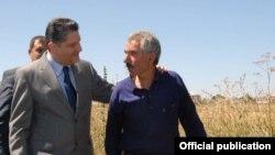 Armenia - Prime Minister Tigran Sarkisian talks to a farmer in Gegharkunik province, 30Aug2011.