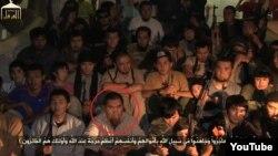 """Мақсат Аймаханов, Қазақстаннан Сирияға аттанған """"жиһадшының"""" бірі (қызыл шеңбер ішінде). YouTube сайтынан алынған скриншот"""