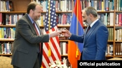 Armenia - Prime Minister Nikol Pashinian (R) visits the U.S. Embassy in Yerevan to congratulate Ambassador Richard Mills on U.S. Independence Day, 3 July 2018.