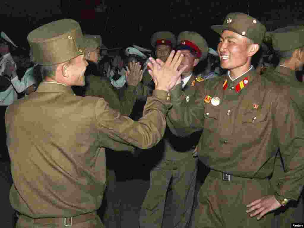 North Korean soldiers attend festivities in central Pyongyang to celebrate North Korean leader Kim Jong Il's reelection as general secretary of the Workers' Party of Korea. Official North Korean KCNA photo provided by Reuters