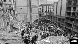 Argentine -- Firemen and policemen search for wounded people after a bomb exploded at the Argentinian Israelite Mutual Association (AMIA) in Buenos Aires, July 18, 1994