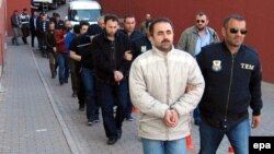 Earlier this year in Turkey, suspected supporters of the U.S.-based cleric Fethullah Gulen were escorted by plainclothed police officers.
