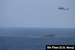 The dhow sailing vessel is shown as it is intercepted in the Arabian Sea.