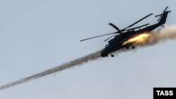 Ми-35 русумидаги Россия вертолëти.