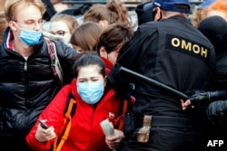 Riot police detained striking students in Minsk on October 26.