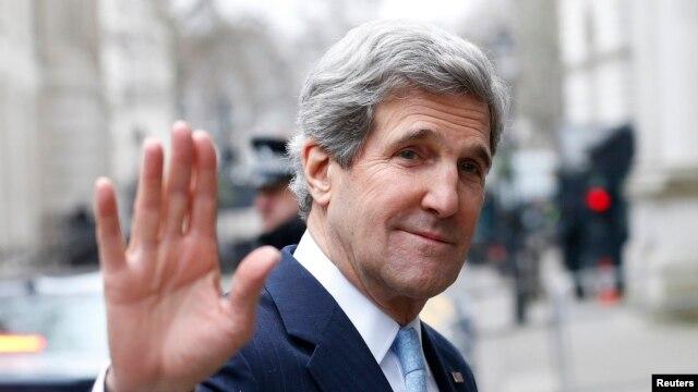 U.K. -- U.S. Secretary of State John Kerry waves as he leaves Number 10 Downing Street in London, 25Feb2013