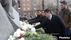 Armenia - People in Gyumri lay flowers at a memorial to victims of the 1988 earthquake, December 7, 2018.