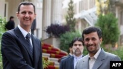 Iranian President Mahmud Ahmadinejad (right) with Syrian President Bashar al-Assad in Tehran