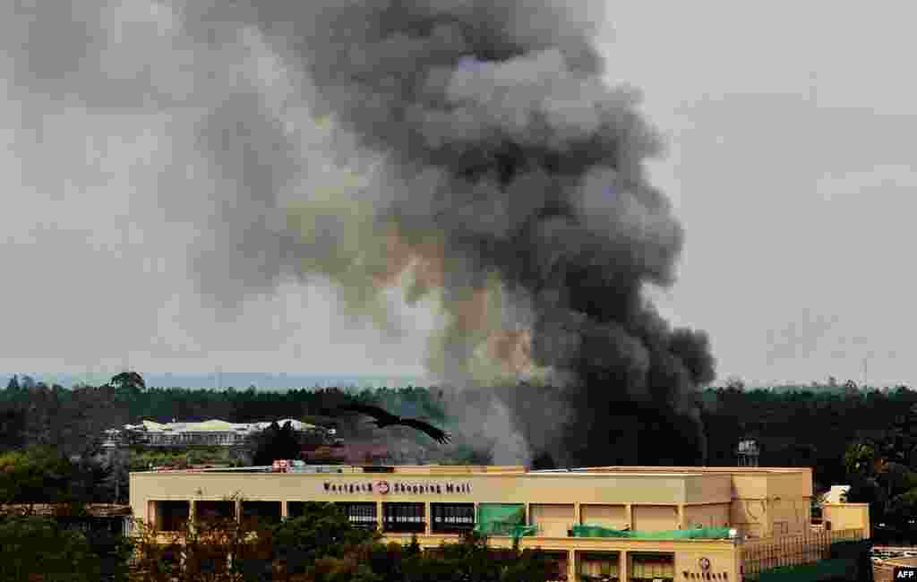 Smoke rises from the Westgate mall in Nairobi on September 23. Militants are continuing to hold an unknown number of hostages there.