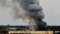 Smoke rises from the Westgate mall in Nairobi as fighting continued on September 23.