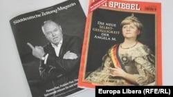 Candidatul social democrat Peer Steinbrück și candidata creștin democrată Angela Merkel pe coperțile a două influente publicații germane.