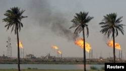 Flames emerge from burning excess gas from the oil fields in Basra. File photo