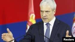Serbian President Boris Tadic gestures during a news conference in Belgrade on December 30.