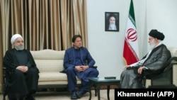 Iranian Supreme Leader Ayatollah Ali Khamenei meets with Pakistani Prime Minister Imran Khan (C) and Iranian President Hassan Rohani (L) in Tehran, October 13, 20169