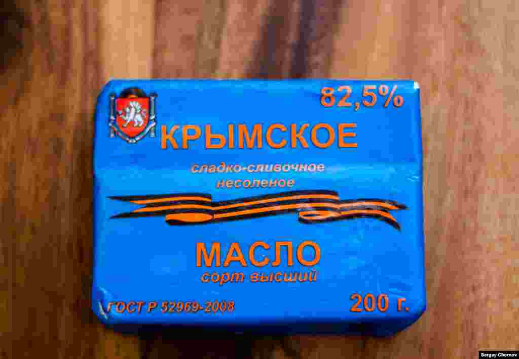 Some of the new products appear to be packaged with the patriotic shopper in mind. One example: Krymskoye Maslo (Crimean Butter), whose label comes adorned with the black-and-orange St. George's ribbon worn by pro-Russian separatists in eastern Ukraine. A similarly beribboned Crimean Vodka is also newly available. Both are produced in the Crimean city of Sevastopol.