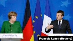 Президент Франції Емманюель Макрон і канцлер Німеччини Анґела Меркель на спільній прес-конференції в Брюсселі, Бельгія, 23 березня 2018 року