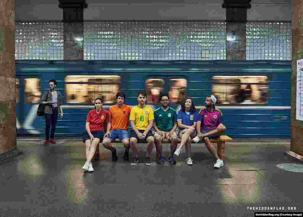 Six gay rights activists from (left to right) Spain, The Netherlands, Brazil, Mexico, Argentina, and Colombia, have taken to the streets of Russia to display the rainbow flag while the World Cup is under way.