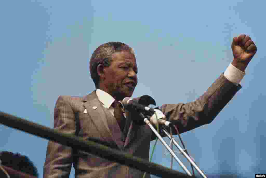 Nelson Mandela raises his fist to the crowd while making a speech in Port Elizabeth shortly after his release in 1990.