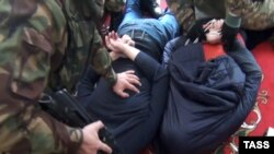 A photo released by the public relations center of the Russian security services showing the arrest of alleged Islamic State extremists in Daghestan. (file image)