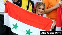 A female supporter of the Syrian national team attends the FIFA World Cup 2018 qualification football match between Syria and Iran at Azadi Stadium in Tehran on September 5.