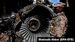 FILE: The wreckage of a state run Pakistan International Airlines, Airbus A320 lies amid houses of a residential colony days after it crashed, in Karachi on May 24.