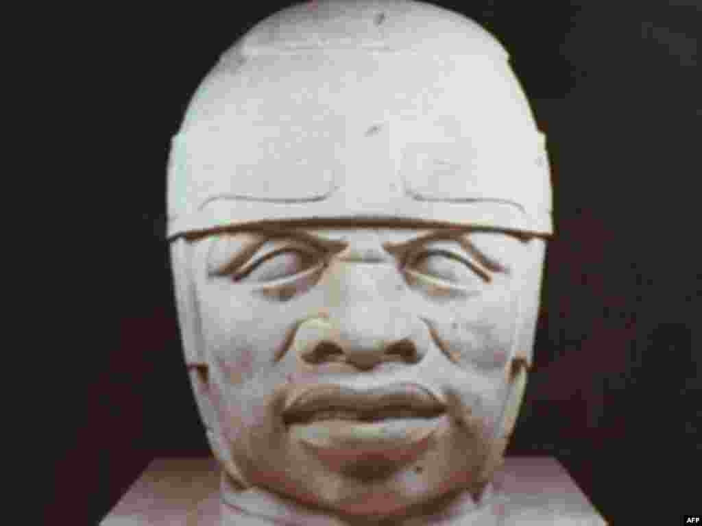 Mexico - This San Lorenzo Monument 8-Colossal Head from the early formative period is part of the Olmec Art of Ancient Mexico exhibition, 15Apr1996