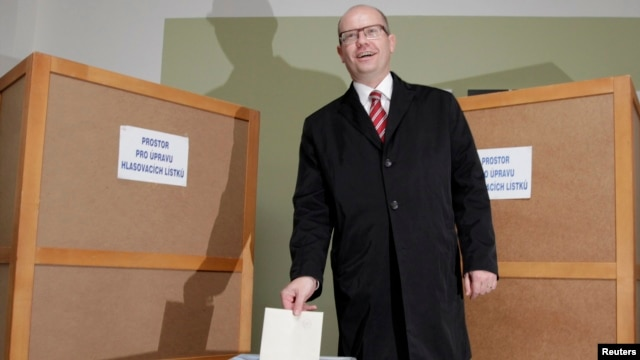 Czech Social Democratic Party leader Bohuslav Sobotka casts his vote at a polling station during an early general election on October 25.