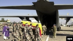 The coffin containing the body of a Spanish soldier in 2007 is carried by comrades to a military plane at the ISAF operations base in Herat, Afghanistan.