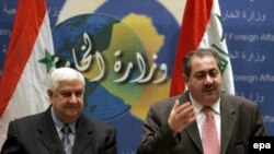 Syria's Foreign Minister Walid al-Muallim (left) and Iraq's Foreign Affairs Minister Hoshyar Zebari