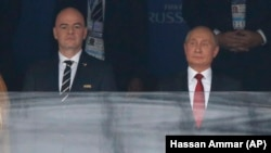 Russian President Vladimir Putin (right) attends the opening match of the soccer World Cup with FIFA President Gianni Infantino.