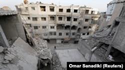 Разрушенный во время войны квартал в Думе, пригороде Дамаска.