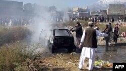 Bazarda bomba partlamasynyň bolan ýeri, Paraçinar, Pakistan, 13-nji dekabr, 2015.