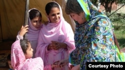Pakistani member of parliament Bushra Gohar (right) visiting a camp of Internally Displaced persons in Khyber Pakhtunkhwa Province.