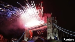 Fireworks explode over Tower Bridge during the opening ceremony of the London 2012 Olympic Games, 27Jul2012