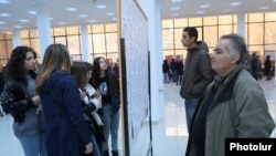Armenia -- People read vacancy notices at a job fair in Yerevan, November 27, 2019.