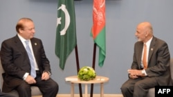 Pakistani Prime Minister Nawaz Sharif (L) speaks with Afghan President Ashraf Ghani during the BRICS/SOC emerging economies summit in the Russian city of Ufa in July 10.