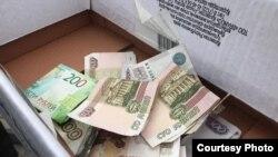 Сбор денег в Крыму для оплаты штрафа, наложенного властями на крымского активиста. Иллюстрационное фото