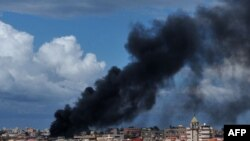 Libya -- Smoke rises from the center of the coastal city of Sirte, 13Oct2011
