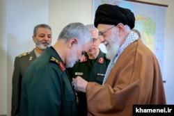 Qasem Soleimani (left) receives Iran's highest military award from Supreme Leader Ayatollah Ali Khamenei last summer.