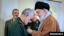 The commander of the Revolutionary Guards' elite Qods Force, Qassem Soleimani (left), receiving Iran's highest military award, the country's supreme leader announced Monday. March 11, 2019.