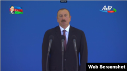Azerbaijani President Ilham Aliyev speaks at a military parade on June 26.