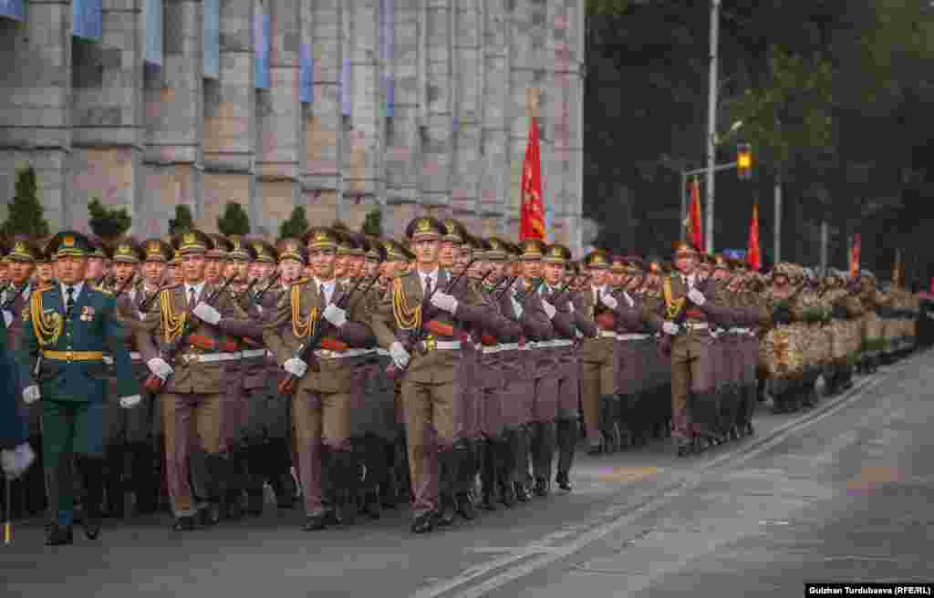 Soldiers march during the parade. Kyrgyzstan's independence era has been marked by successes in some areas, such as a relatively free press, but the country's economy lags far behind other former Soviet republics.