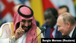 ARGENTINA -- Saudi Arabian Crown Prince Mohammed bin Salman speaks with Russia's President Vladimir Putin during the opening of the G20 leaders summit in Buenos Aires, November 30, 2018
