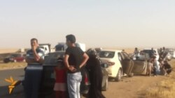 Iraqi Families Flee Mosul Fighting